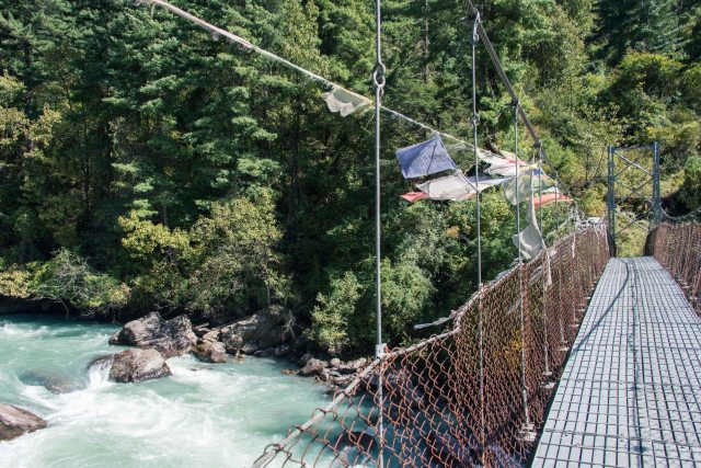 Bridge over glacial water,Bhutan