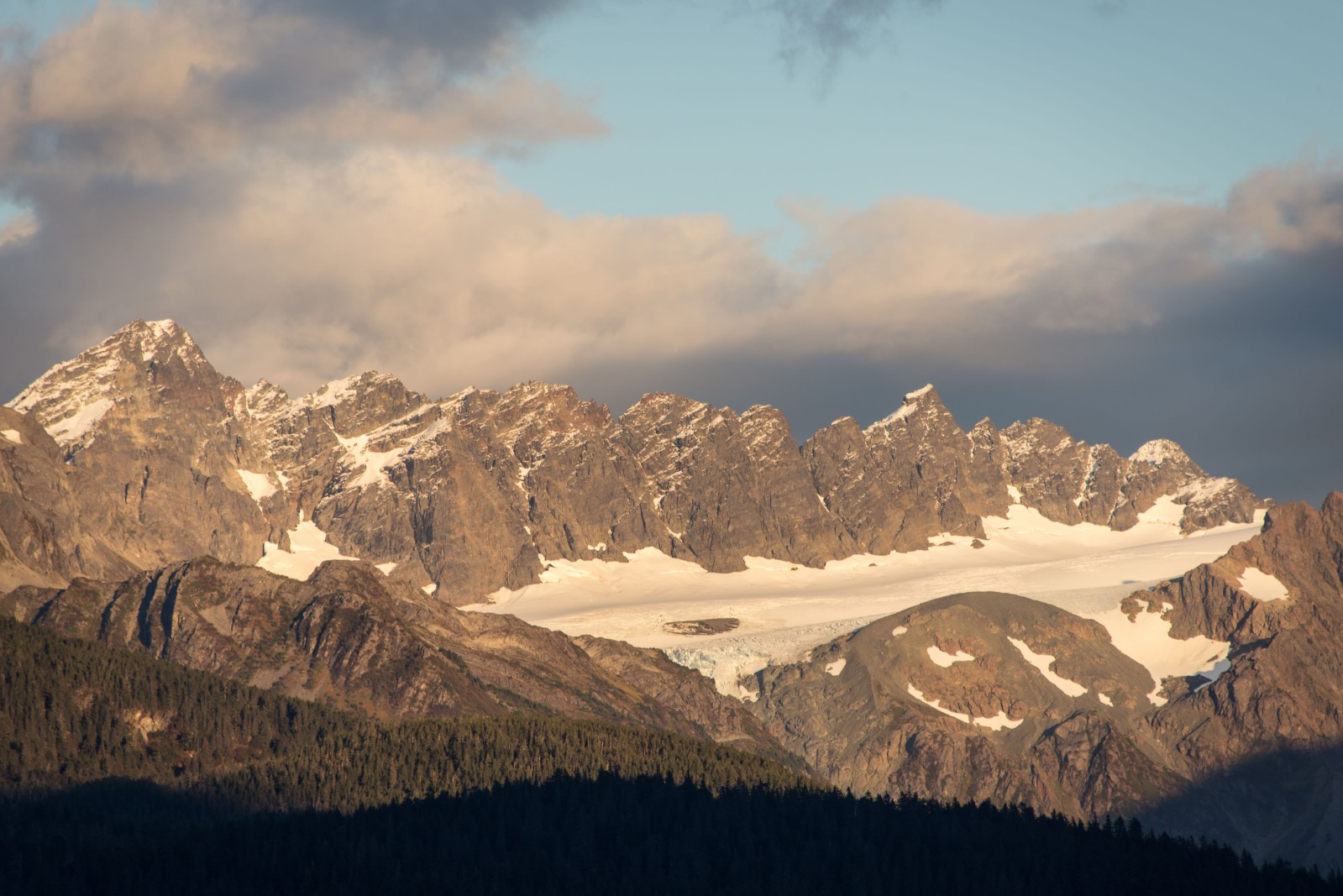 Golden light on jagged mountain peaks in Seward, Alaska
