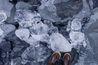 Ice chunks and Xtra Tuff boots on rocky stream bed