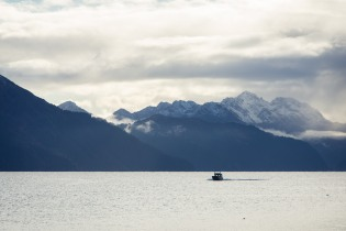 Boat in a bay surrounded by mountains