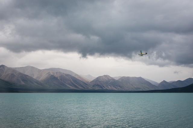 a float plane prepares to land on upper twin lake on a cloudy day